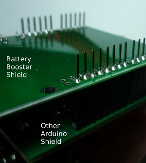Solder long header pins into shield