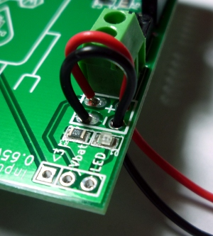 You can solder your battery wires directly using the strain-relief holes