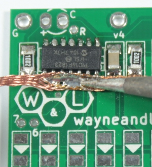 Use solder wick to remove large blobs and bridges