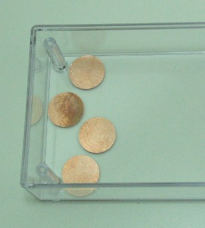 Apply copper foil buttons inside the top of the clear case